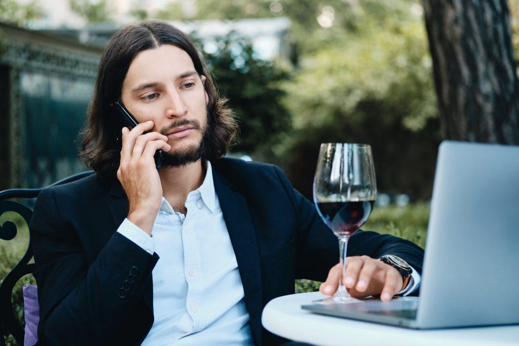 Man, wine, laptop