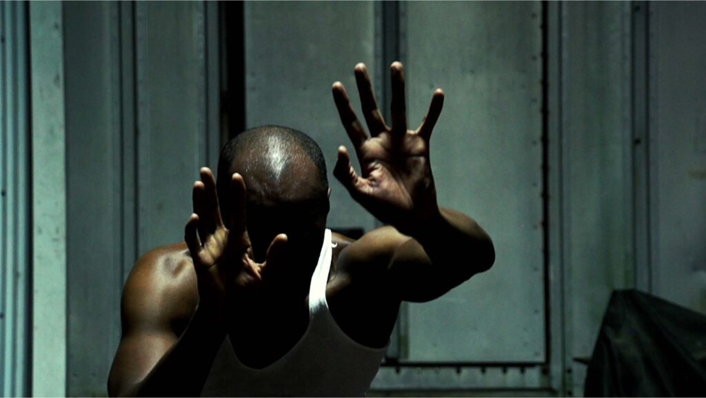 A still from the film BLACK STAINS